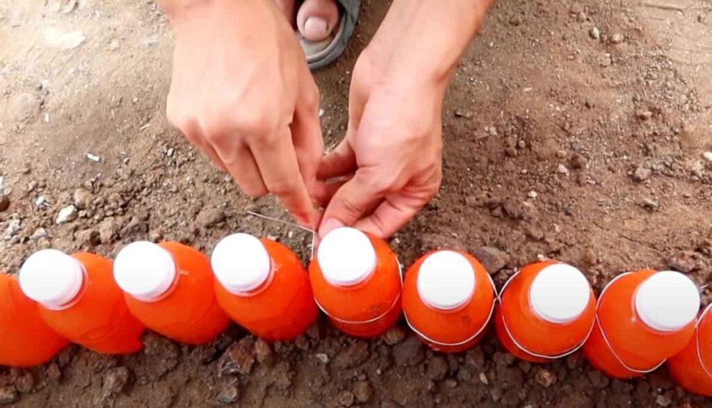 foto 6 – Цветочная клумба из пластиковых бутылок